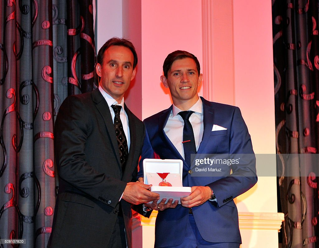 Aurelio Vidmar presents Craig Goodwin with the Club Champion during the 2016 Adelaide United Awards Night on May 4, 2016 in Adelaide, Australia.