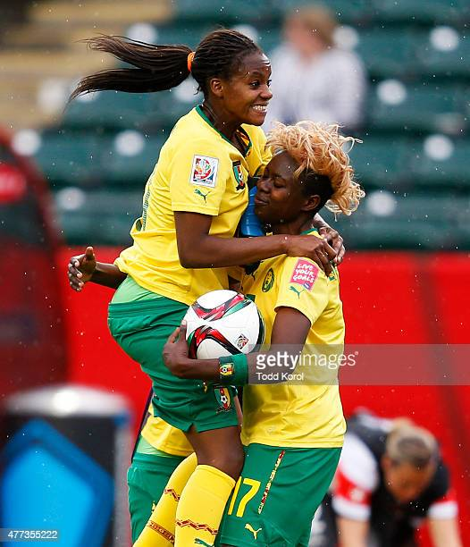 Aurelle Awona celebrates with teammate Gaelle Enganamouit of Cameroon during the FIFA Women's World Cup Canada Group C match between Switzerland and...