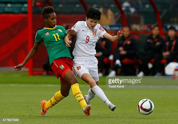 Aurelle Awona of Cameroon tries to slow down Wang Shanshan of China during the FIFA Women's World Cup Canada Round 16 match between China and...