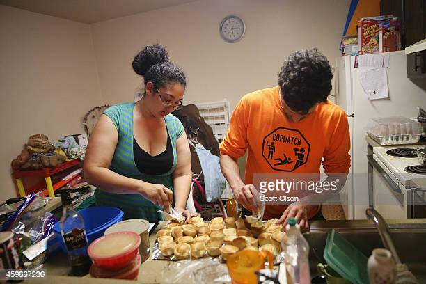 Aurellia Davis and Jacob Crawford prepare Thanksgiving dinner at Davis's home in the Canfield Green Apartments where Michael Brown was killed on...