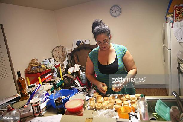 Aurellia Davis prepares Thanksgiving dinner at her home in the Canfield Green Apartments where Michael Brown was killed on November 27 2014 in...