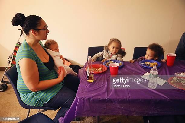 Aurellia Davis sits down with her children Byron Aurolla and David for Thanksgiving dinner on November 27 2014 in Ferguson Missouri Aurella and her...