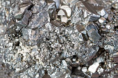 Horizontal full frame of Auriferous Pyrite (Fe S2) gray stone crystals background. The cluster is fully crystallized on all sides with no point of attachment.