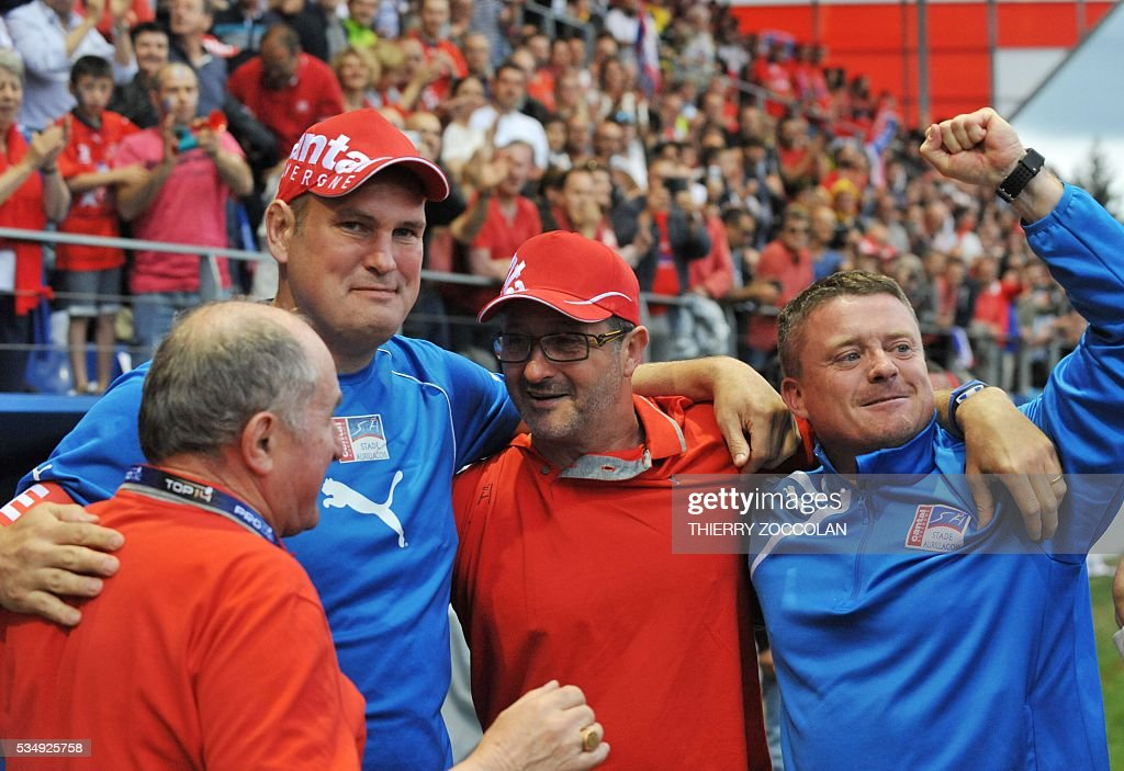 Aurillac's Irish coach Jeremy Davidson (L), Aurillac's French coach Thierry Peuchlestrade (C) and Aurillac's doctor Sebastien Delpirou (R) celebrate at the end of the French Union Pro D2 rugby match Aurillac vs Mont-de-Marsan at the Jean Alric stadium in Aurillac, central France, on May 28, 2016.