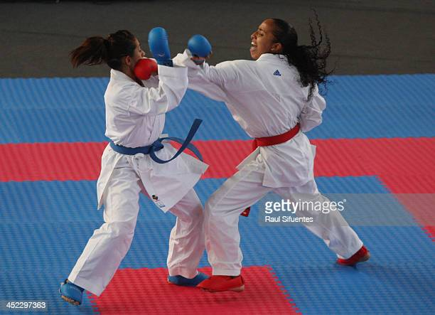 Aurimer Campos of Venezuela and Gabriela Bruna of Chile compete in women's karate 50 kg finals as part of the XVII Bolivarian Games Trujillo 2013 at...