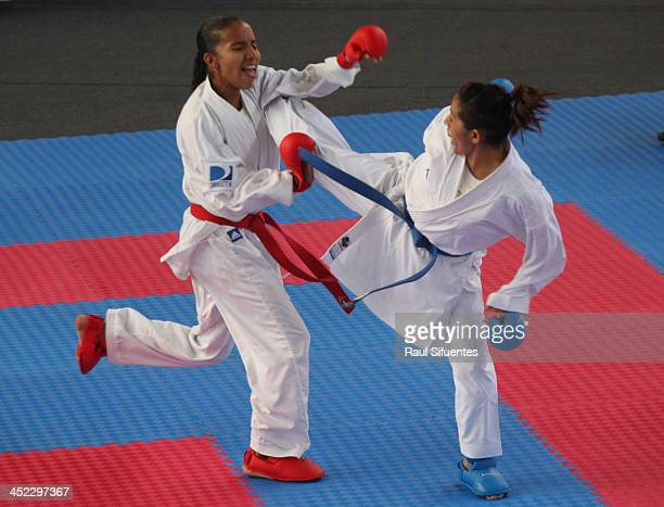Aurimer Campos of Venezuela and Gabriela Bruna of Chile compete in women's karate 50kg finals as part of the XVII Bolivarian Games Trujillo 2013 at...
