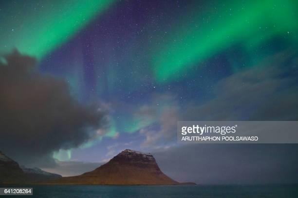 Aurora borealis at scandinavia , mt. kirkjufell, iceland