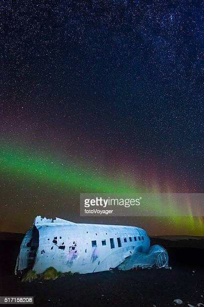 Aurora Borealis Northern Lights in starry sky above plane Iceland
