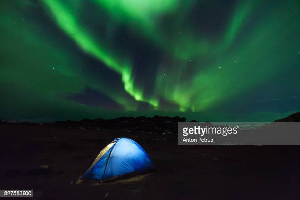 Aurora Borealis on Iceland and a camping tent