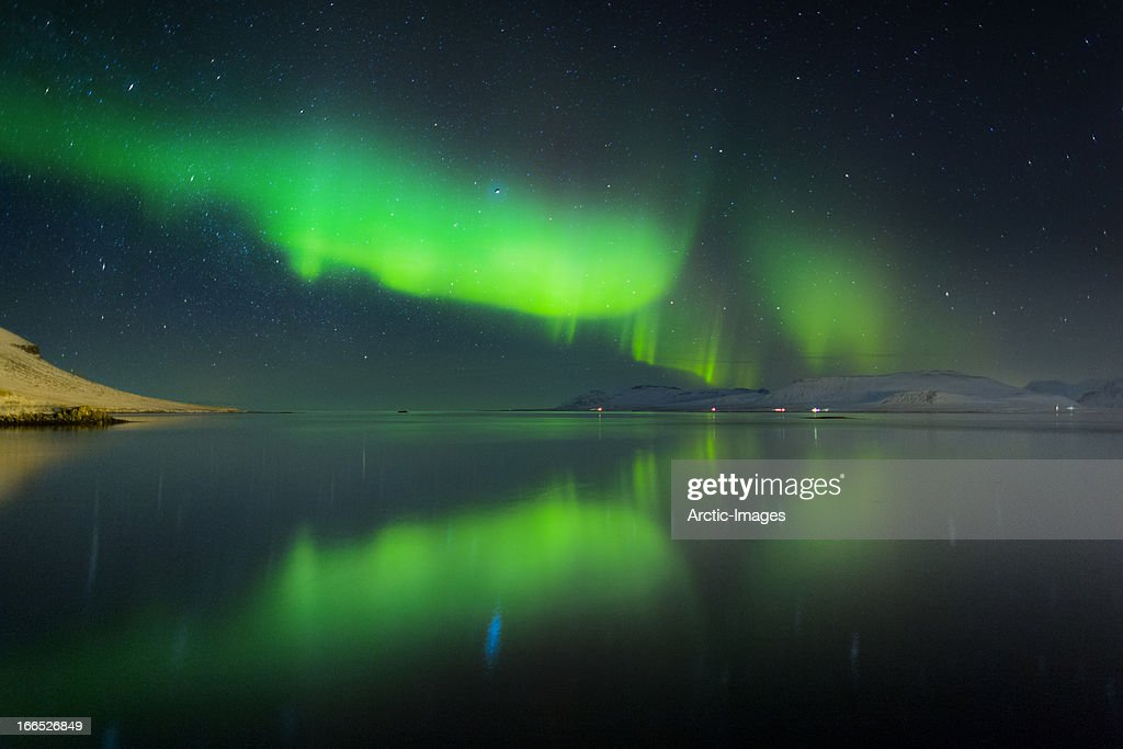 Aurora Borealis or Northern lights over a fjord : Stock Photo