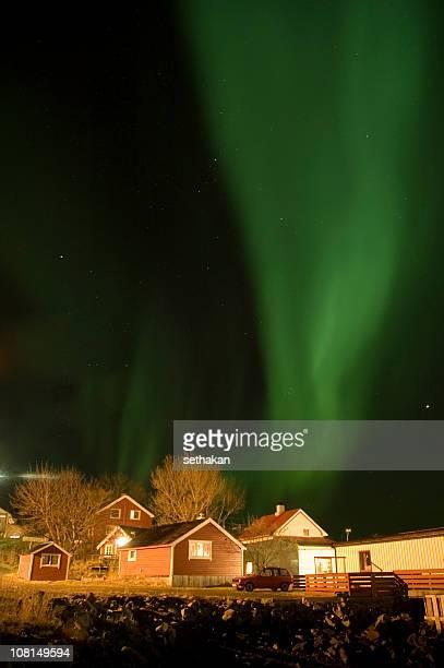 aurora borealis over boathouse