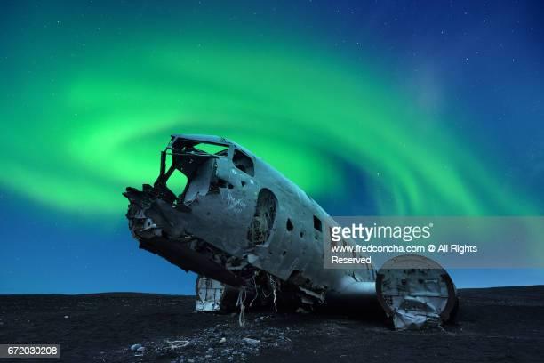 Aurora borealis over Douglas DC-3 Plane wreckage