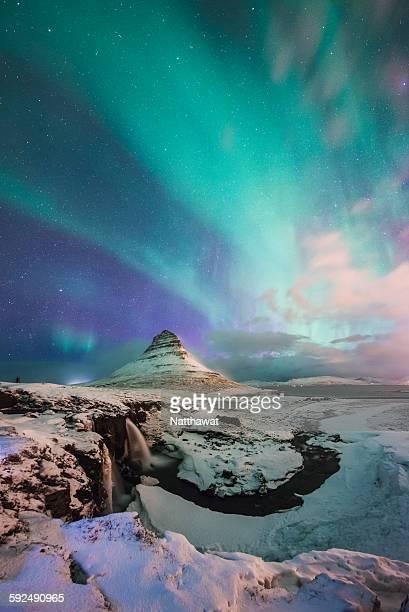 Aurora Borealis over Kirkjufell Mountain Iceland