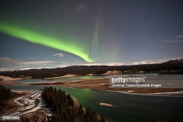Aurora borealis over Yukon River, Yukon, Canda.