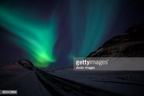 Aurora Borealis with Winter Road, Iceland : Stock Photo