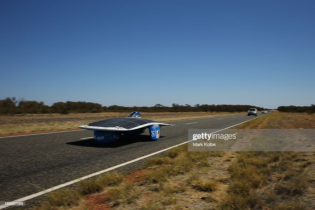Aurora Evolution from the Aurora Vehicle Association team, Australia races in the GoPro Adventure Class on Day 4 on October 9, 2013 between Alice Springs and Kulgera, Australia. Over 25 teams from across the globe are competing in the 2013 World Solar Challenge - a 3000 km solar-powered vehicle race between Darwin and Adelaide. The race began on October 6th with the first car expected to cross the finish line on October 10th.