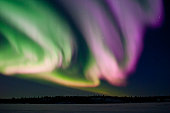 Aurora (northern lights) in pink, purple and green