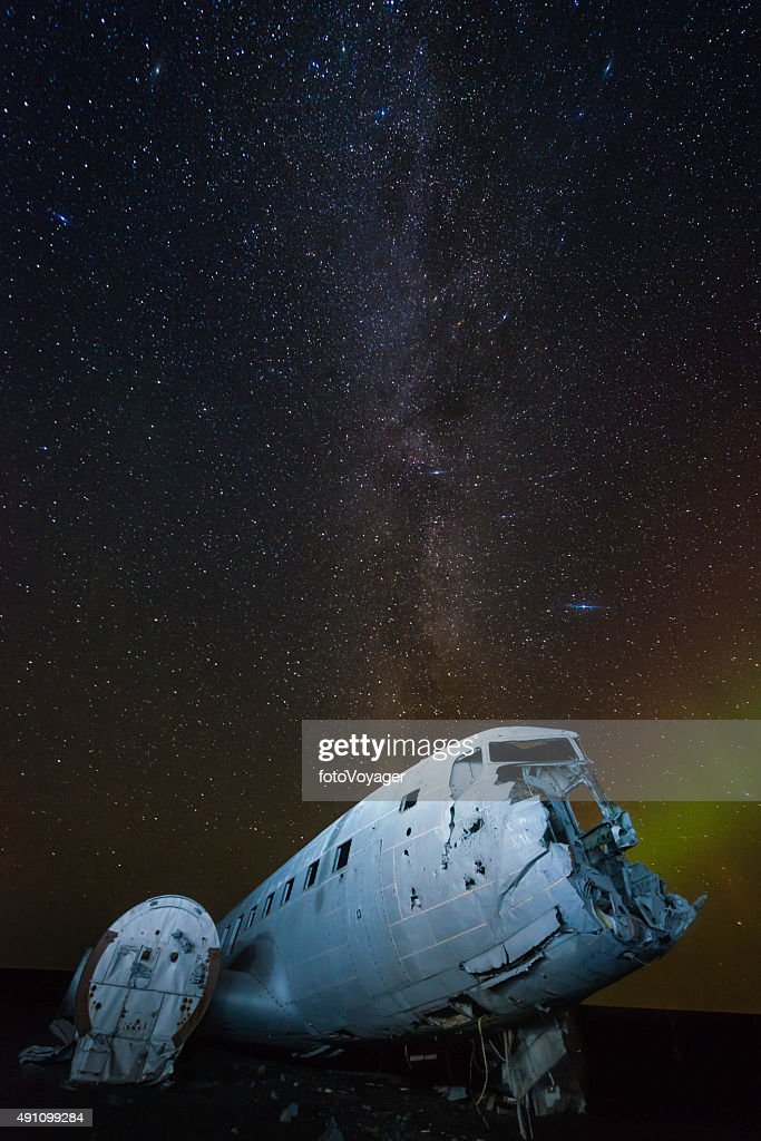 Aurora milky way galaxy stars over plane crash beach Iceland : Stock Photo