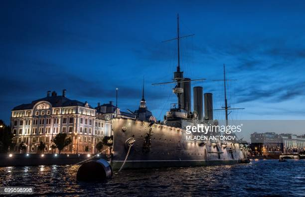 TOPSHOT Aurora museum ship is docked at Neva river bank in Saint Petersburg during the early hours of June 22 2017 In 1917 Aurora's gun signaled the...