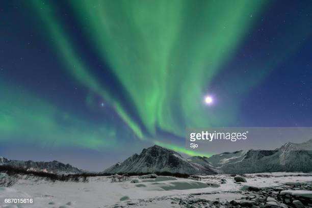 Aurora Northern Polar light in night sky over Northern Norway