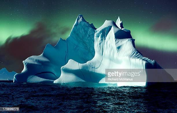 Aurora over icebergs
