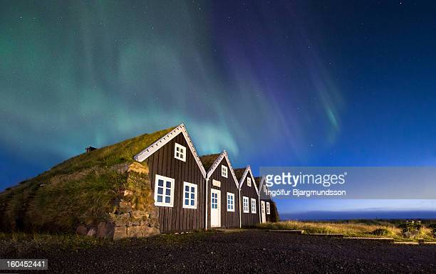Aurora over old house