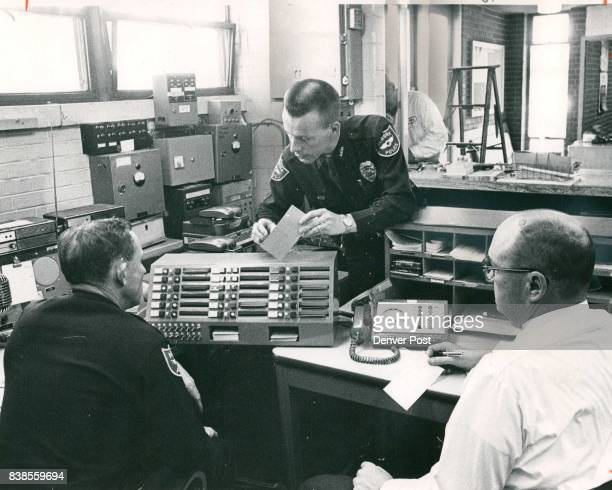 Aurora Patrolmen Prepare to Operate the Department's Status Board From left the men Richard Rusk Charles Alumbaugh and Archie Ezell are on duty...