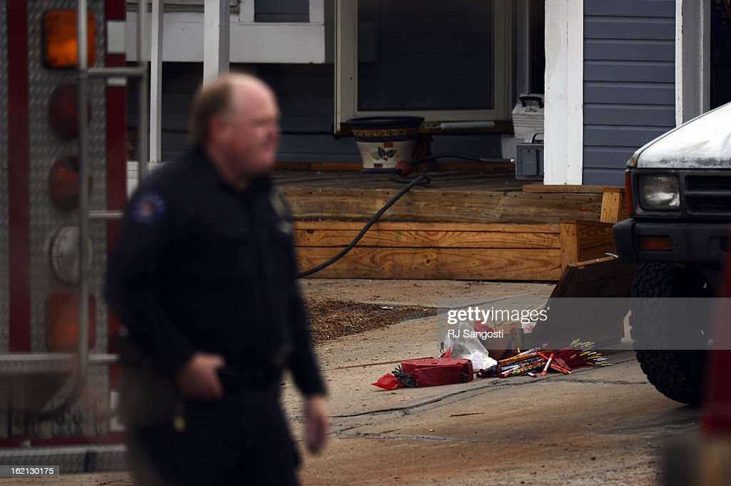 Aurora Police continue to work a scene where a homeowner was arrested after firefighters and police found homemade explosive devices, bomb making materials, and illegal fireworks, February, 19, 2013. Police identified the homeowner as 55-year-old Michael Grover.