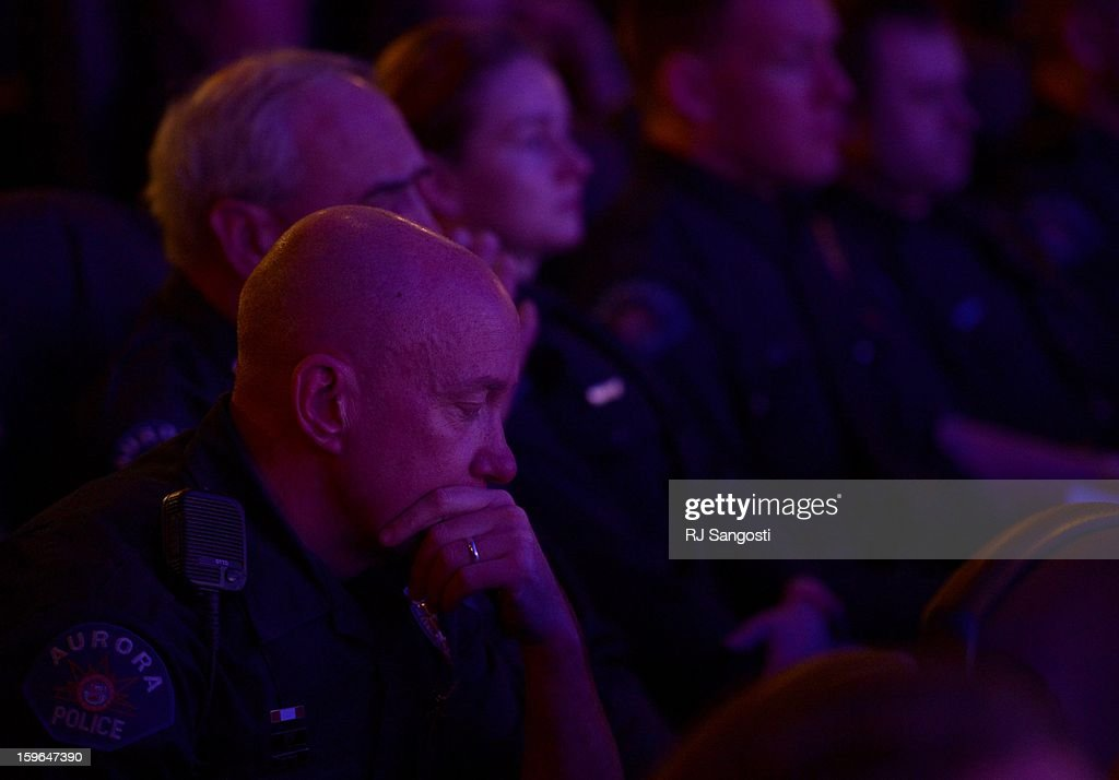 Aurora Police Officer Mike Hawkins, a 18 year veteran and first responder to the shooting sits with other Aurora Police officers during the reopening and remembrance in Theater I XD of the Century Aurora Theater. James Holmes is accused of killing 12 people and wounding 70 others on July 20, 2012 in theater 9.
