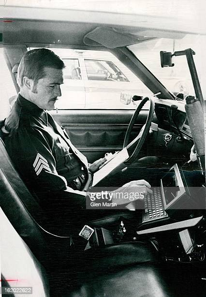 DEC 24 1980 DEC 31 1980 Aurora police officer Sgt JJ Henry above uses his new incar computer The $25 million computer dipatch system allows officers...
