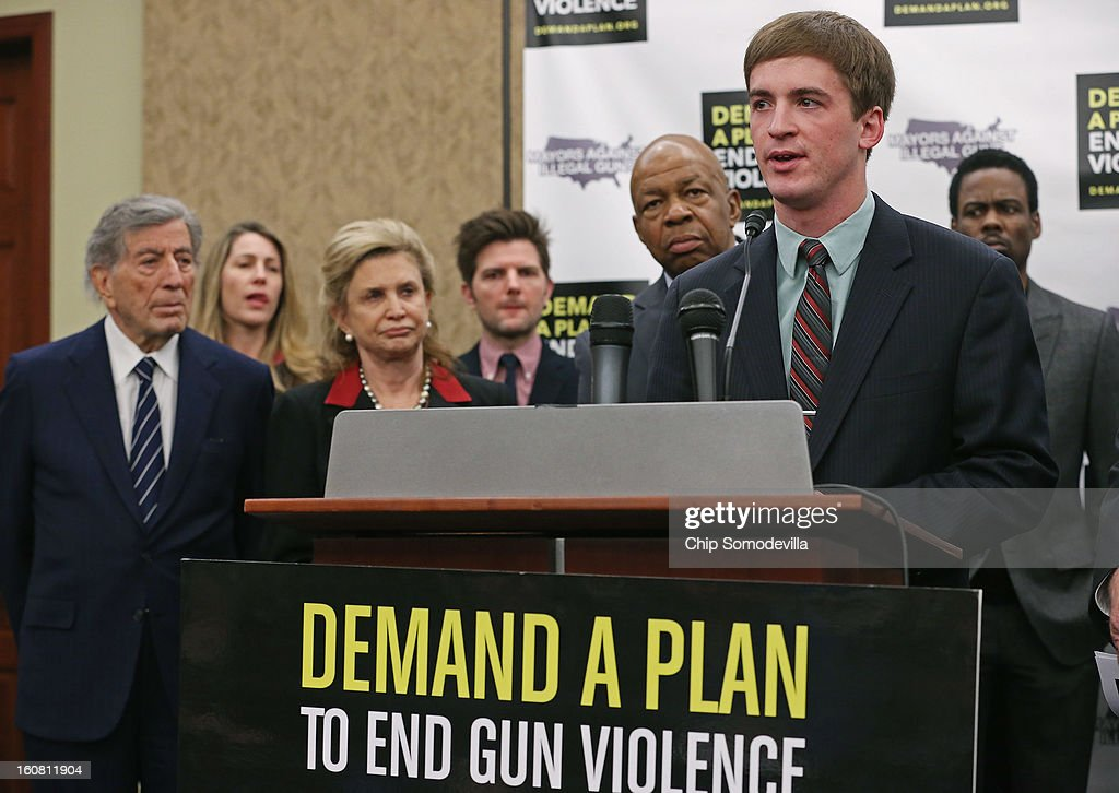 Aurora theater shooting victim Stephen Barton, (2nd R) speaks during a press conference hosted by the Mayors Against Illegal Guns and the Law Center to Prevent Gun Violence with (L-R) singer Tony Bennett, LCPGV Executive Director Robyn Thomas, Rep. Carolyn Maloney (D-NY), actor Adam Scott, Rep. Elijah Cummings (D-MD) and actor Chris Rock at the U.S. Capitol February 6, 2013 in Washington, DC. The artists, activists and politicians called for manditory background check on all gun purchases among other restrictions.
