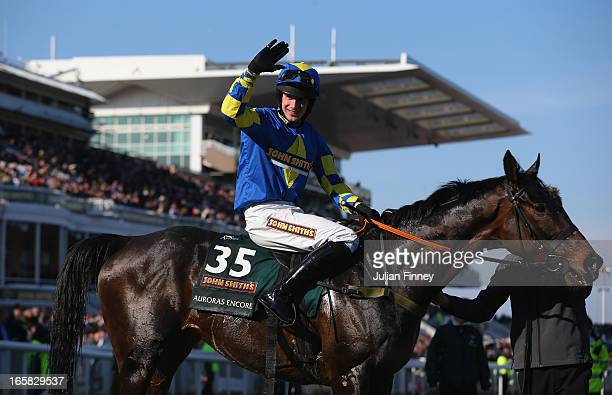 Auroras Encore ridden by Ryan Mania celebrates winning the John Smiths Grand National at Aintree Racecourse on April 6 2013 in Liverpool England