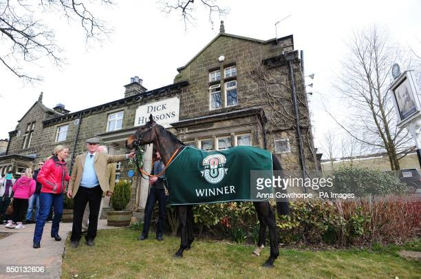 Auroras Encore with trainer Harvey Smith outside their local pub the Dick Hudsons during the winners photocall near Craiglands Farm Bingley