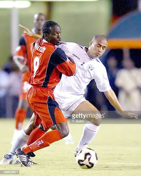 Aurtis Whitley of Trinidad pushes Asthor Henriquez off the ball during a match at the Orange Bowl Miami Florida July 7 2005 The game ended in a 11 tie