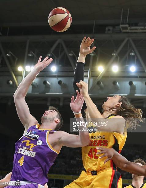 Auryn MacMillan of the Tigers and Andrew Ogilvy of the Kings compete for the ball during the round 21 NBL match between the Melbourne Tigers and the...