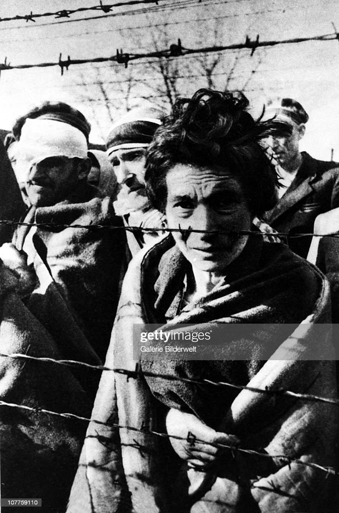 Auschwitz Concentration Camp, A few of the survivors of Auschwitz I are standing near the fence during the arrival of the Red Army. 27th January 1945. Soldiers of the Soviet Union in the First Army of the Ukrainian Front, under the command of Marshal Koniev liberated the camp. Poland.