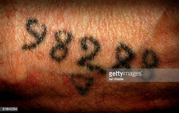 Auschwitz survivor Mr Leon Greenman prison number 98288 displays his number tattoo on December 9 2004 at the Jewish Museum in London England Mr...