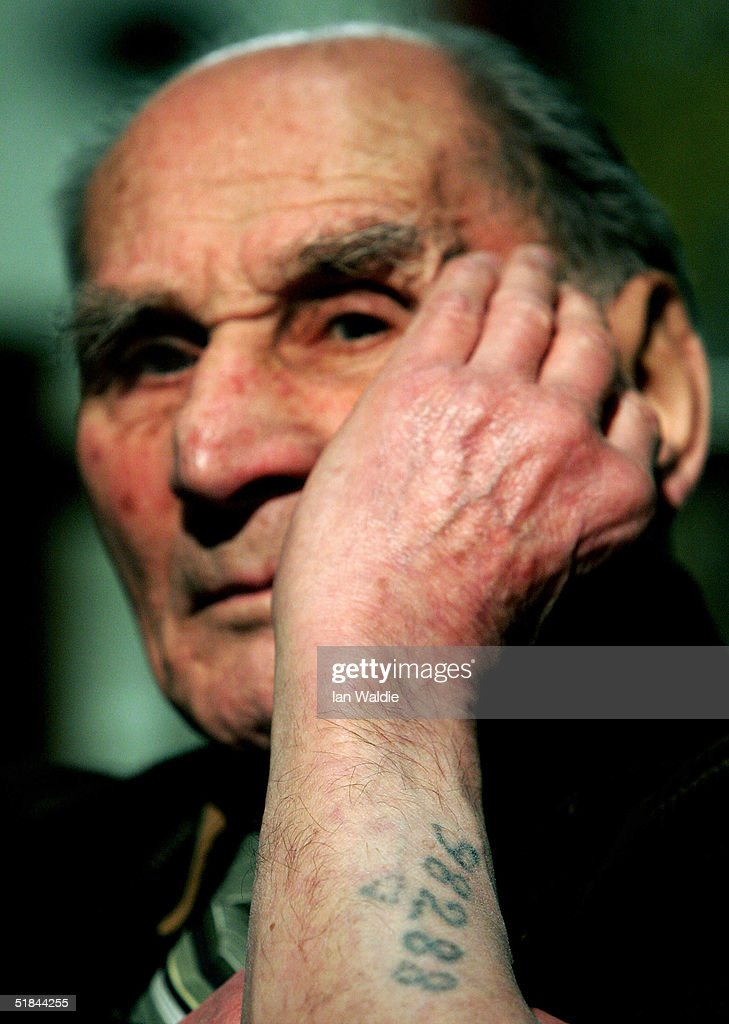 Auschwitz survivor Mr Leon Greenman, prison number 98288, displays his prison number tattoo on December 9, 2004 at the Jewish Museum in London, England. Mr. Greenman O.B.E age 93 and a British citizen, spent three years of his life in six different concentration camps during World War II and since 1946 he has tirelessly recounted his life through his personal exhibition at the museum where he conducts educational events to all age groups. January 2005 will be the 60th anniversary of the liberation of the extermination and concentration camps, when survivors and victims who suffered as a result of the Holocaust will commemorated across the world.
