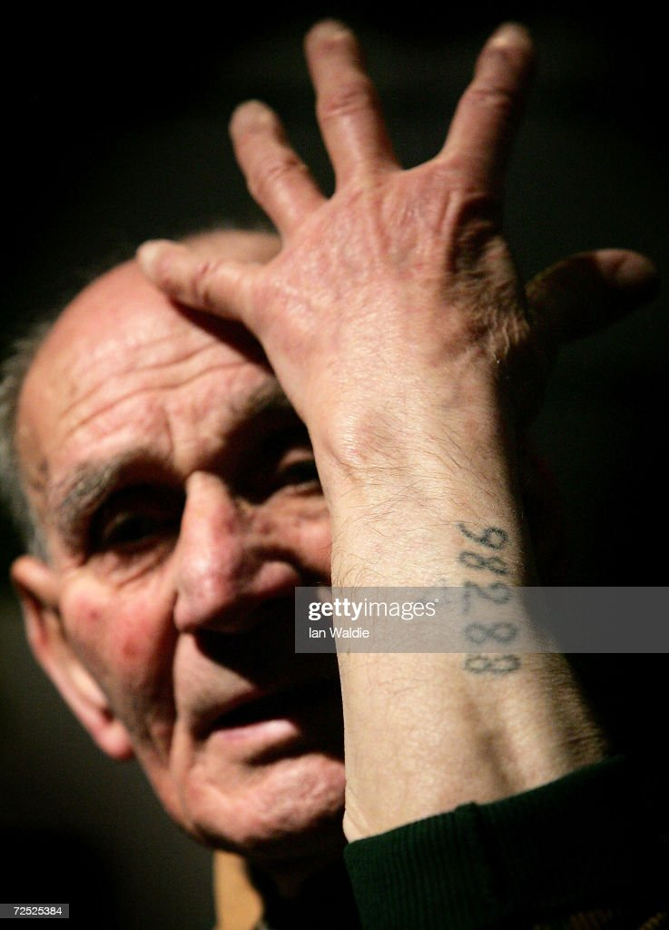Auschwitz survivor Mr. Leon Greenman, prison number 98288, shows his prison number tattooed on his arm December 9, 2004 at the Jewish Museum in London, England. Mr. Greenman O.B.E age 93 and a British citizen, spent three years of his life in six different concentration camps during World War II and since 1946 he has tirelessly recounted his life through his personal exhibition at the museum where he conducts educational events to all age groups. January 2005 will be the 60th anniversary of the liberation of the extermination and concentration camps, when survivors and victims who suffered as a result of the Holocaust will commemorated across the world.