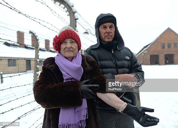 Auschwitz survivor Rose Schindler from USA and her husband Max who was in other camps show their hands with prisoner's numbers as they both return to...