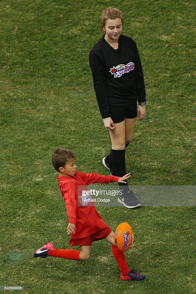 Auskick kids take to the field before warm up during the round 14 AFL match between the St Kilda Saints and the Geelong Cats at Etihad Stadium on June 25, 2016 in Melbourne, Australia.