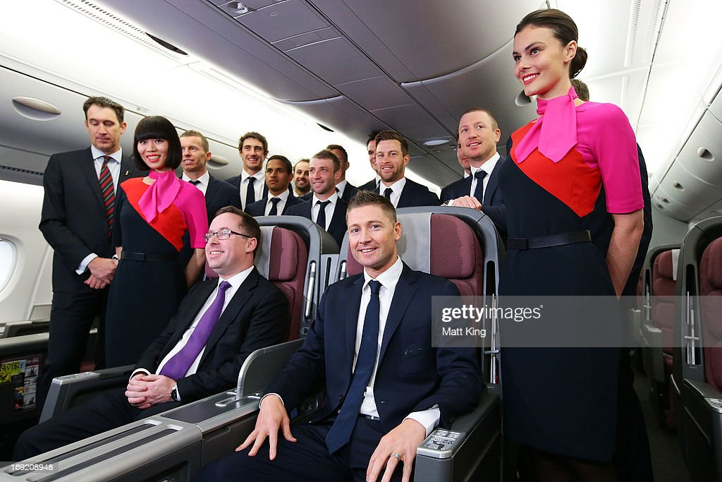 Austalian captain Michael Clarke (R) and members of the Australian cricket team pose with Qantas CEO Alan Joyce (L) in a Qantas A380 during the Cricket Australia Ashes official team farewell at Sydney International Airport on May 22, 2013 in Sydney, Australia.