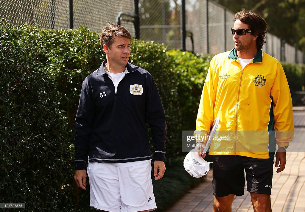 Austalian Davis Cup captain Pat Rafter (R) and Tennis Australia's head of professional tennis <a gi-track='captionPersonalityLinkClicked' href=/galleries/search?phrase=Todd+Woodbridge&family=editorial&specificpeople=204233 ng-click='$event.stopPropagation()'>Todd Woodbridge</a> (L) walk to speak to the media after an Australian practice session ahead of the Davis Cup World Group Playoff Tie between Australia and Switzerland at Royal Sydney Golf Club on September 12, 2011 in Sydney, Australia.