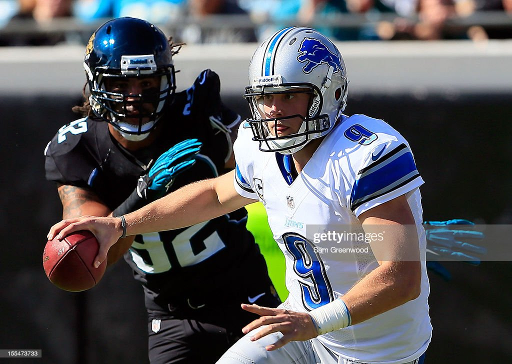 Austen Lane #92 of the Jacksonville Jaguars pressures <a gi-track='captionPersonalityLinkClicked' href=/galleries/search?phrase=Matthew+Stafford&family=editorial&specificpeople=3228634 ng-click='$event.stopPropagation()'>Matthew Stafford</a> #9 of the Detroit Lions during the game at EverBank Field on November 4, 2012 in Jacksonville, Florida.