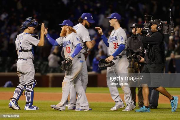 Austin Barnes Justin Turner Kenley Jansen and Cody Bellinger of the Los Angeles Dodgers celebrate after beating the Chicago Cubs 61 during game three...