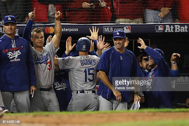 Austin Barnes of the Los Angeles Dodgers celebrates after scoring off of an RBI single hit by Carlos Ruiz in the seventh inning against the...