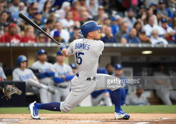 Austin Barnes of the Los Angeles Dodgers hits a grand slam during the first inning of a baseball game against the San Diego Padres at PETCO Park on...