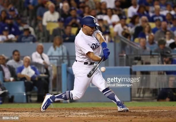 Austin Barnes of the Los Angeles Dodgers hits a threerun homerun in the fifth inning during the MLB game against the San Diego Padres at Dodger...