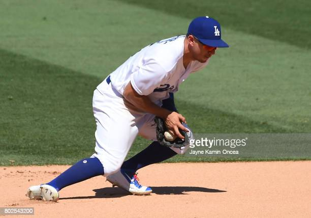 Austin Barnes of the Los Angeles Dodgers makes a play at second base in the game against the Colorado Rockies at Dodger Stadium on June 25 2017 in...