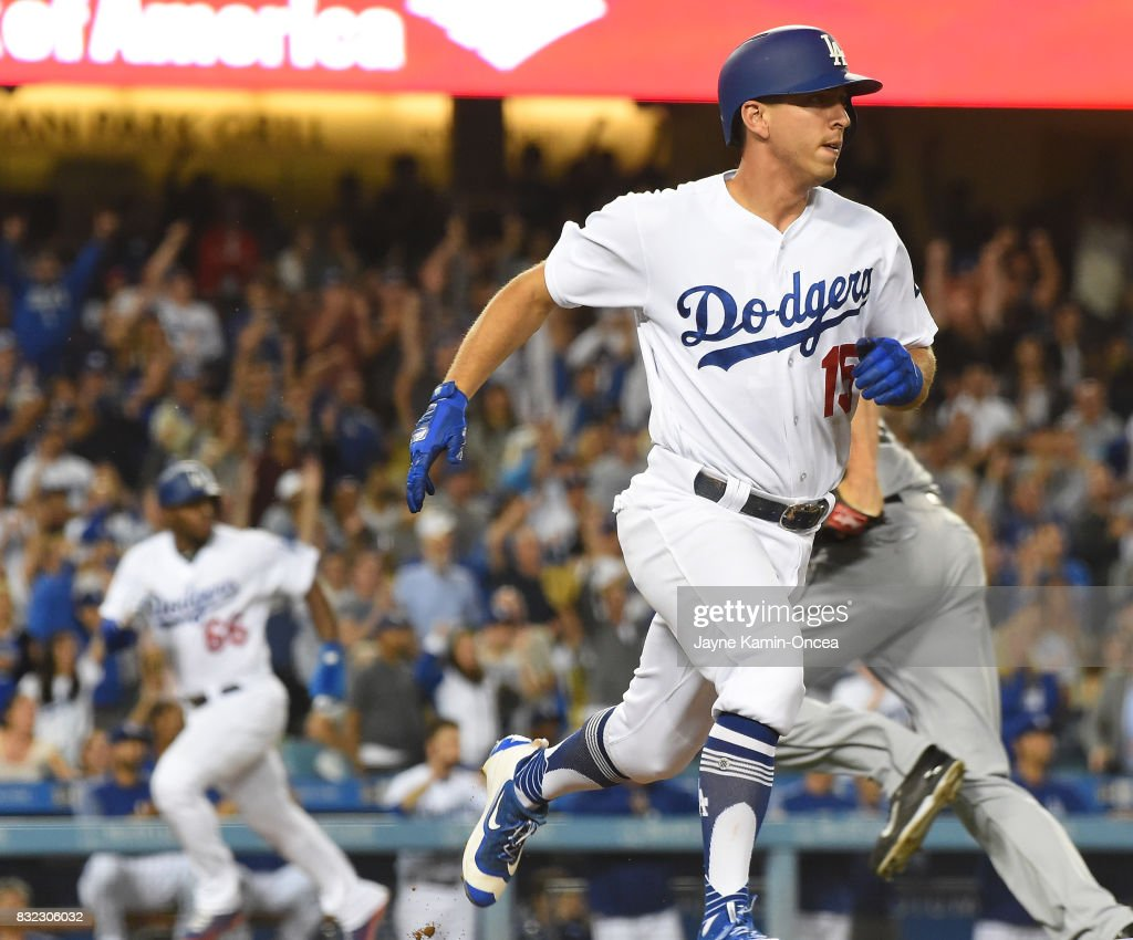 Austin Barnes #15 of the Los Angeles Dodgers pinch it hit a two RBI single in the eighth inning of the game against the Chicago White Sox at Dodger Stadium on August 15, 2017 in Los Angeles, California.